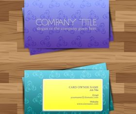 Business card on wood floor Free vector