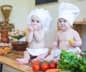 2 cook costume Baby and food Stock Photo