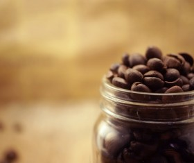 A blurred photograph of a glass of coffee beans