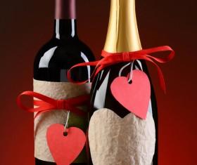 A heart-shaped decoration on a wine bottle
