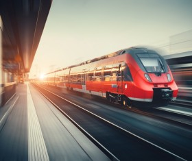 A train running under the dawn Stock Photo