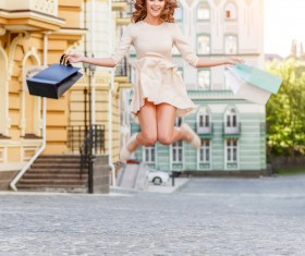 After shopping Excited woman jumping Stock Photo 01