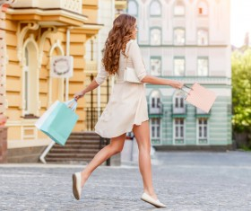 After shopping Excited woman jumping Stock Photo 02