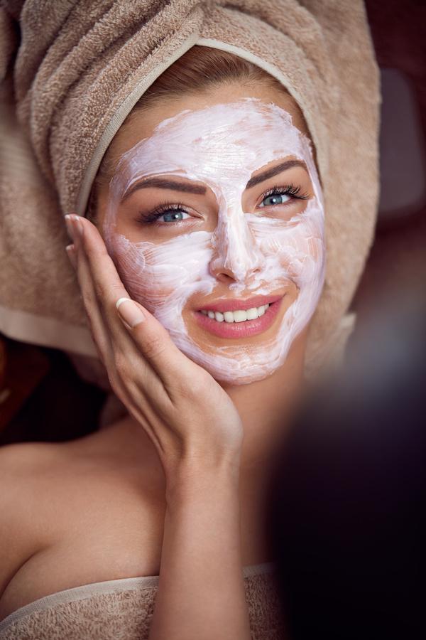 Apply mask beauty woman Stock Photo