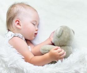 Baby sleeping with teddy bear Stock Photo