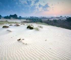 Barren desert and distant background of the sun