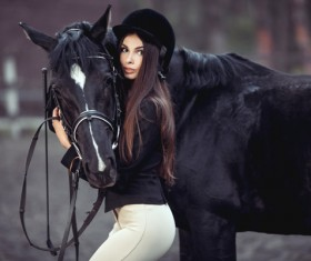 Beautiful girl and dark horse embrace
