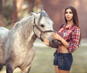 Beautiful girl with gray horse