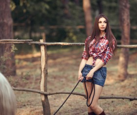 Beautiful girl with horse and forest background