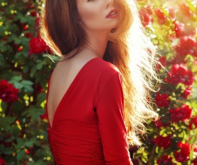 Beautiful woman with stylish flowers photo