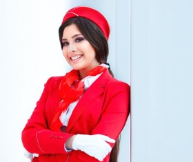 Beautiful young stewardess leaning against the wall HD picture
