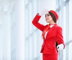Beautiful young stewardess with a white background HD picture