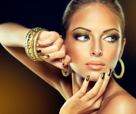 Beautiful young woman with fashion jewelry