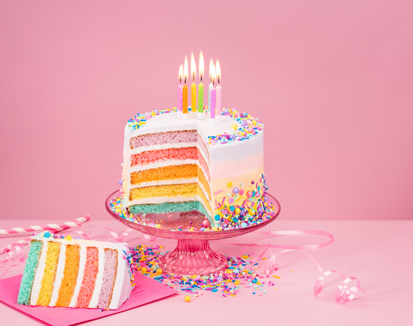 birthday cake with candles and pink background free download