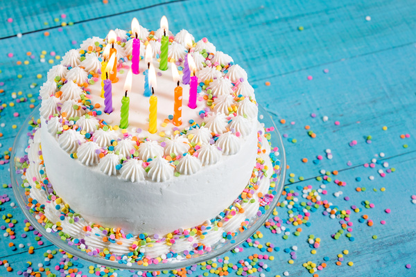 Birthday cake with candles on a blue background ...