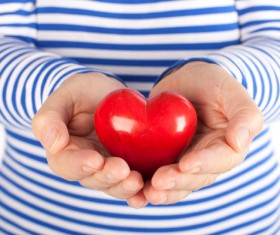 Blue white background holding a red heart-shaped Stock Photo