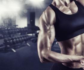 Bodybuilder female body with black background