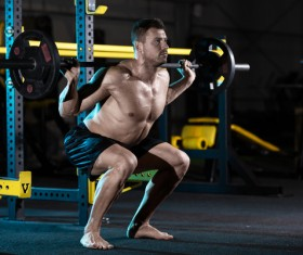 Carrying a barbell exercise gym male HD picture