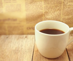 Coffee and newspaper wiht blurs background