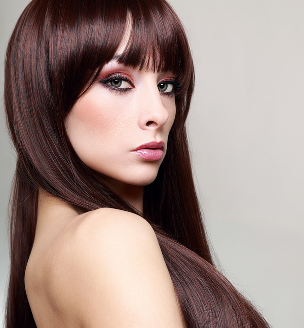 young beautiful woman dark red hair