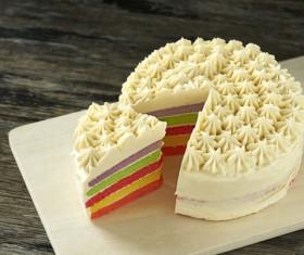 Cut rainbow layer cake