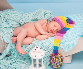 Cute newborns and lanterns in bed Stock Photo