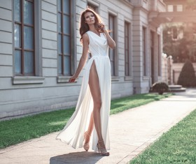 Dressed in a white dress beautiful woman's fashion photo 01