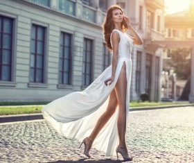 Dressed in a white dress beautiful woman's fashion photo 02