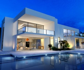 External view of a contemporary house with pool at dusk Stock Photo