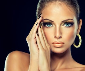 Fashion models beautiful jewelry black eyelashes golden nails