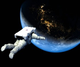 Floating astronauts fly to Earth Stock Photo