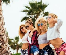 Four beautiful young blonde girls with fun in sunglasses fun