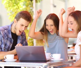 Friends are happy to see the game cheering Stock Photo