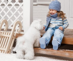 Girl sitting on the promenade and white puppy Stock Photo