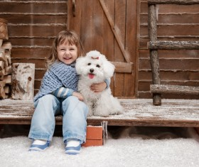 Girl with white puppy laughing Stock Photo