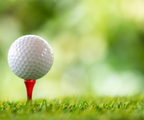 Golf ball with green background