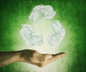 Green background hand holding white clouds shape recycling sign