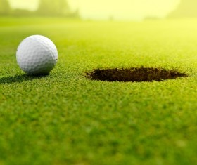 Green hole in the edge of the golf Stock Photo