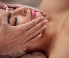 HD picture Beautician with massage techniques to customer skin care