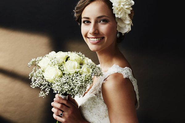 Hand Held Bouquet Of Smiling Young Beautiful Bride