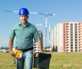 Hand toolbox Construction worker with building crane background