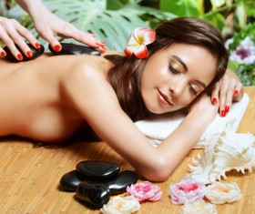 Head inserted flowers beautiful topless female relaxing spa Stock Photo