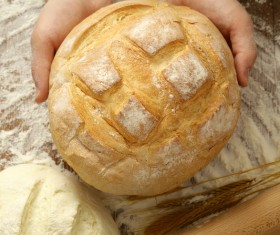 Holding bread and dough on the table