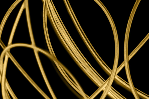 Intertwined gold lines and a black background 02