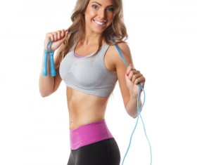 Jumping rope Young woman exercising