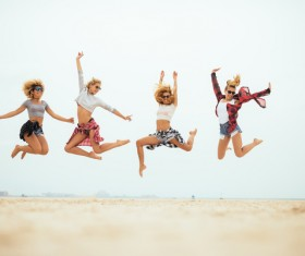 Jumping young beautiful girl on the beach HD picture