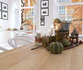 Kitchen with pumpkin on the table and views out the window