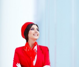 Leaning against the glass wall looking at the sky smiling flight attendants