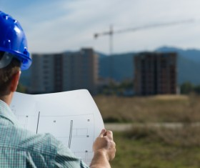 Look at the drawings of the building engineer with the fuzzy building background 01