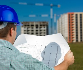 Look at the drawings of the building engineer with the fuzzy building background 02